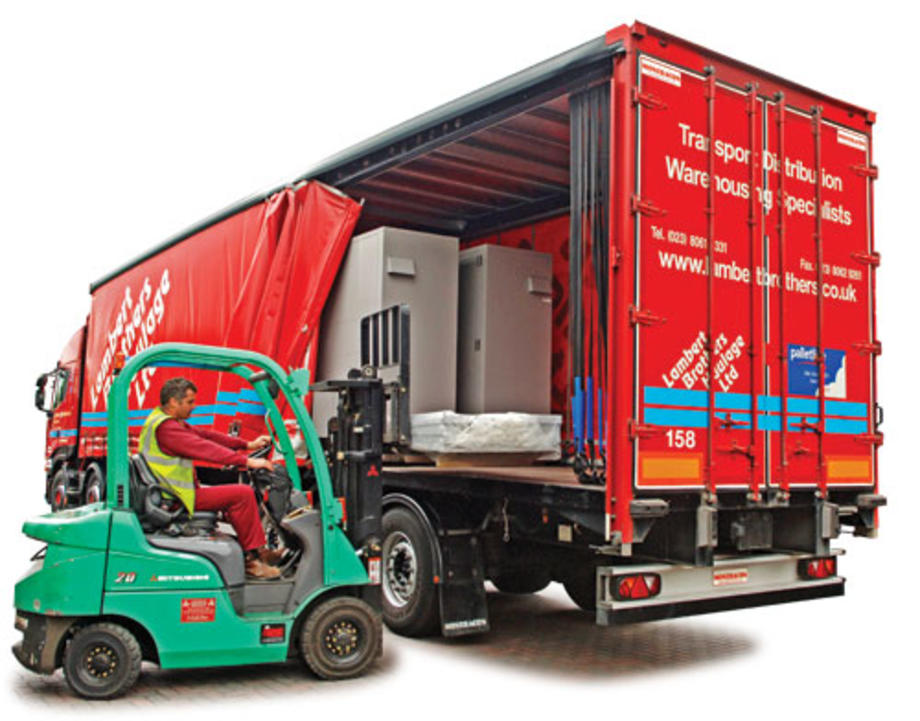 Picture of a curtainsider trailer being emptied by forklift