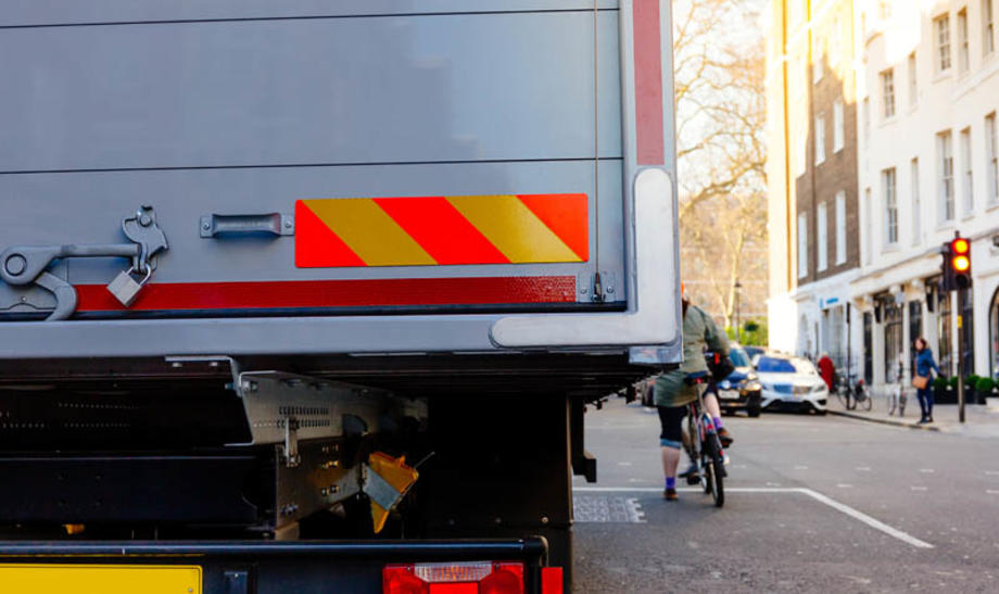 Truck in London and cyclist