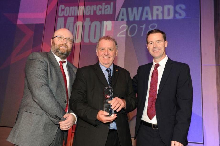 Brian Currie collects award